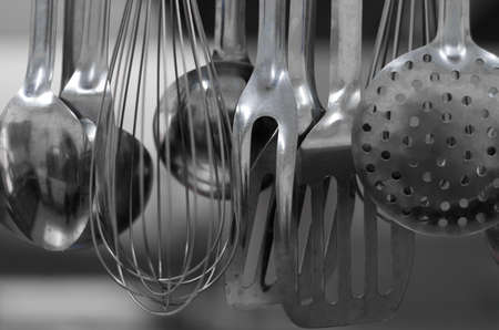 implements: Ladles collection in a restaurant kitchen Stock Photo