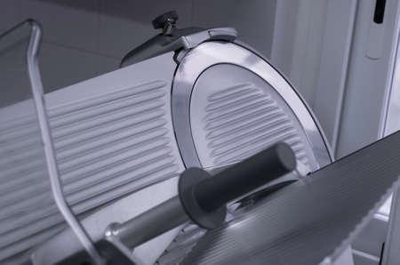 slicer: Close up of a professional slicer used in restaurant kitchen