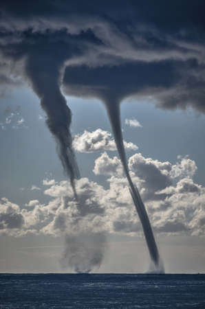 waterspout: Tornados over mediterranean sea in a sunny winter day