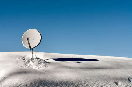 polar station: Sattelite dish Placed on the roof of mountain house covered of snow