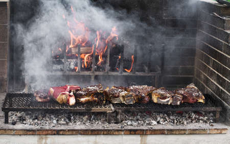 Thick slices of meat from chianina cow grilling over the embers Stock Photo
