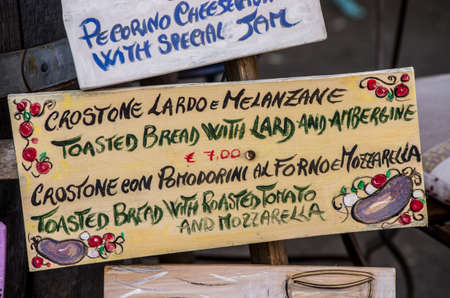 panino: This is an handmade food signboard, met in a small tuscany village, where a shop was selling typicals product of food and wine. Stock Photo
