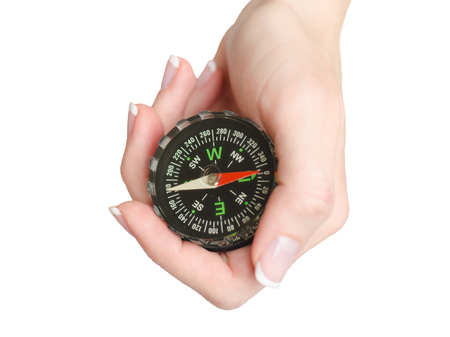 Hand of a young woman holds a compass isolated on white background Stock Photo