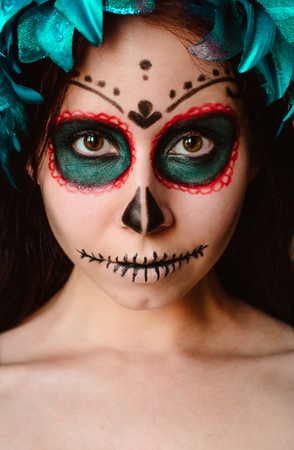 Young caucasian woman in catrina calavera style makeup and blue flower crown vertical portrait close up face Stock Photo