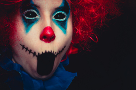 Creepy clown close up spooky halloween portrait on black background Stock Photo - 113299784
