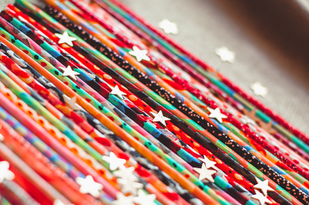 Colorful painted sticks bright vivid abstract background. Concept of different handmade stuff