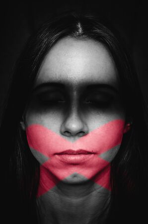 Female portrait with marks of blindness and silence. Concept of quiet victim of discrimination and woman who prefers not to look at face of problems and keep silent because of victim blaming Stock Photo