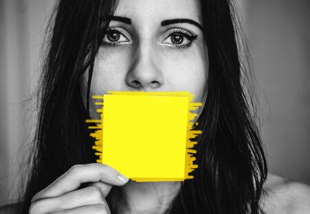 Woman with a sticker near her mouth as a concept of female rights and necessity of talking and writing about that from each person. Copy space for any text