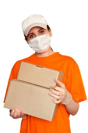 Delivery girl wears medical face mask and gloves and holds two boxes. Concept of safe services during covid-19 outbreak. Courier isolated on white background Imagens