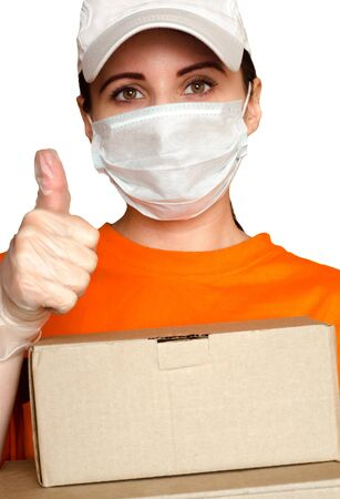 Delivery girl wears medical face mask and gloves and holds two boxes close-up portrait. Concept of safe services during covid-19 outbreak. Courier on white background
