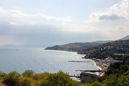 top veiw: A kind is from above on a beach and sea. The Black sea, Malorechenskoe, Crimea. Stock Photo