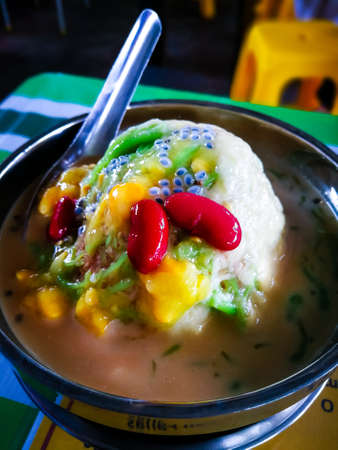 ice kacang or ais kacang (ABC) in Malay language, a colorful Malaysian dessert made of shaved ice, beans and colorful jelly. Stock Photo