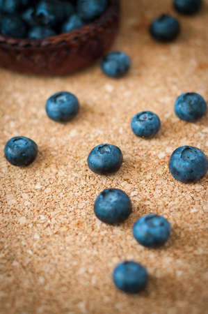 Freshly picked blueberries in woven natural screw pine leaf bowl. Juicy and fresh blueberries with on rustic table. Bilberry on wooden Background. Blueberry antioxidant. Concept for healthy eating.