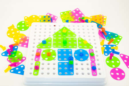 Colourful puzzles with house concept on a white background. Stock Photo
