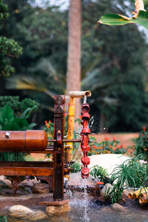 musical water wheel, inventive traditional system to irrigate water while making a beautiful sound.