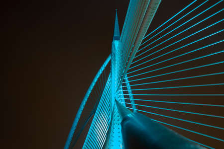 Night view of modern bridge architecture at Putrajaya, Malaysia in different colors.