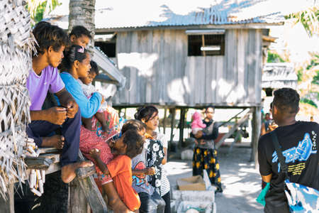 Sibuan, Malaysia - November 26, 2019: Bajau Laut people in their village in Sibuan island, aSemporna. They inhabit villages on the island.