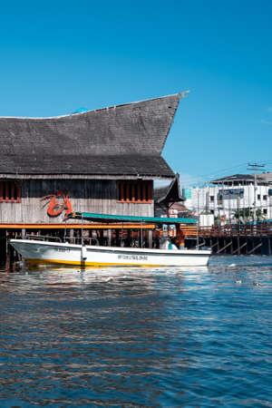 Semporna, Malaysia - November 28, 2019 :  Boats, houses, and jetty near the Semporna Town.