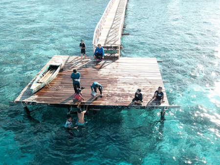 Aerial view of children playing at pier, in Semporna, Borneo Sabah, Malaysia. Stock Photo