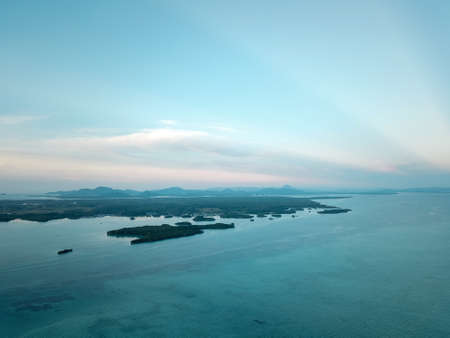 Aerial wide panorama of Bum Bum Island against an early morning blue sky colourful sunrise in Semporna, Borneo Sabah, Malaysia. 写真素材
