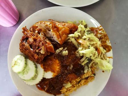 Close up or top view Malaysia famous cuisine. Nasi Kandar or Kandar Rice