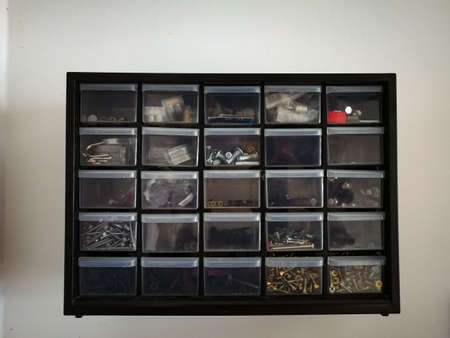 Plastic drawer for keeping small items. Organization at home. 免版税图像