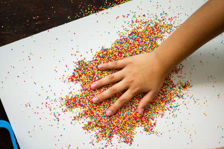 Playing with the colourful sugar sprinkles. Fun activites for children. Fine motor skills.