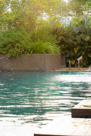 Swimming pool scene during golden hours.