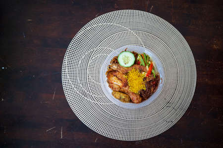 Nasi Ambeng or Nasi Ambang. It is a fragrant rice dish that consists of steamed white rice, chicken curry or chicken stewed in soy sauce, beef or chicken rendang, sambal goreng urap, bergedel.