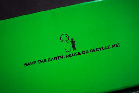 Save the earth, reuse or recycle me logo and text on a green background.