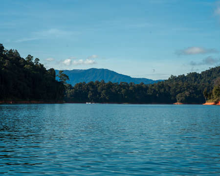 Kenyir lake small islands with beautiful rainforest tropical jungle. Scenic landscape view. Located in Terengganu, Malaysia.