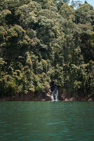Kenyir lake lake with beautiful rainforest tropical jungle. Scenic landscape view. Located in Terengganu, Malaysia.