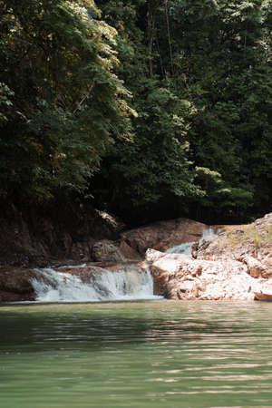 Lasir waterfall flowing in Lake Kenyir, Terengganu Malaysia.