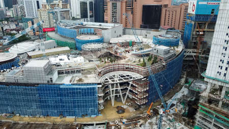 Bukit Bintang, Malaysia - July 17, 2020: aerial view of a construction site in city center. Building of a new mall in Kuala Lumpur, Malaysia. Bukit Bintang City Center. 新聞圖片