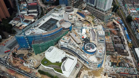 Bukit Bintang, Malaysia - July 17, 2020: aerial view of a construction site with crane in city center. Building of a new mall in Kuala Lumpur, Malaysia. Bukit Bintang City Center.