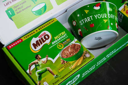 Kuala Lumpur, Malaysia - Nov 7 2020: Nestlé Milo breakfast energy drink in pumpkin and sunflower seed. Bowl with text