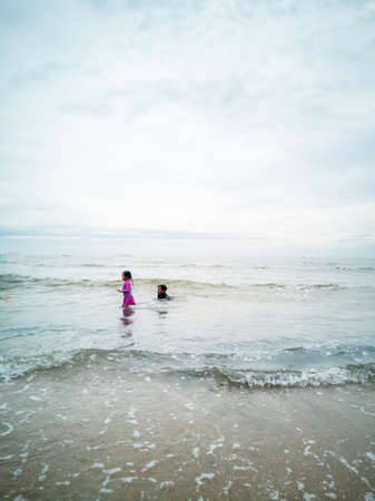 Children swimming at the beach in Malaysia.