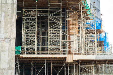 building under construction with scaffoldings.