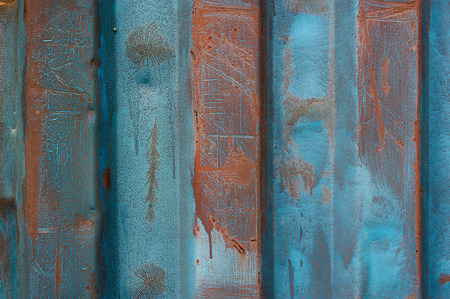 Grunge metal background  Detail of the paint peeling from a metallic container  photo