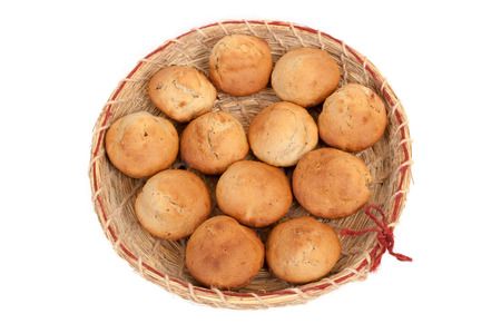 handwork: The homemade baking is in the handwork wattled dish. Stock Photo