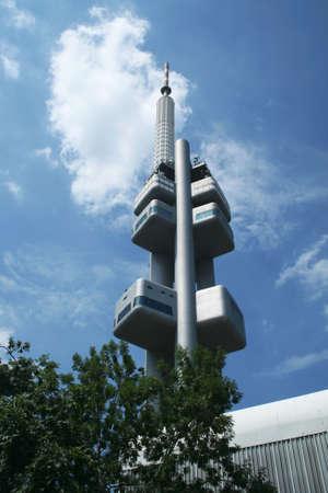 Communications mast from below, city Prague Czechia.