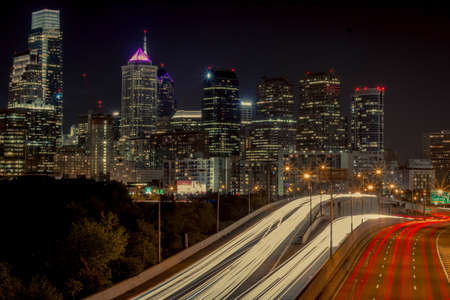 light trails: The Philadelphia skyline, with light trails from traffic in the foreground Editorial