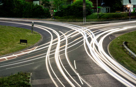 Crisscrossing light trails on a roundabout