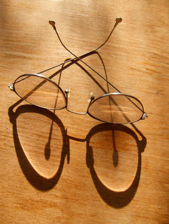 Pair of spectacles on the yellow table Stock Photo - 980031
