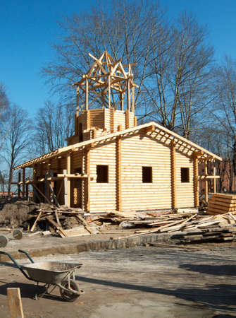 Construction the large log house with a turret at top