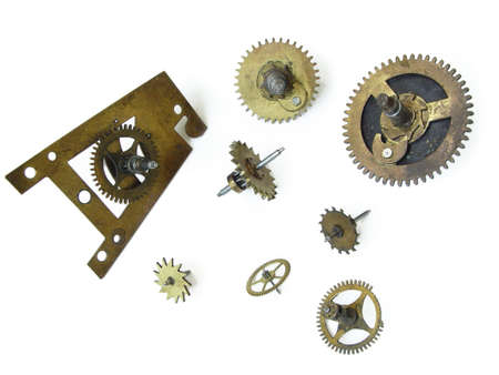 diminutive: The clock cog-wheels. Objects over white.