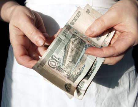 indigence: Ten rubles in hands of old women Stock Photo