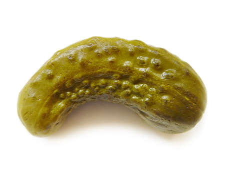 crooked: One crooked pickled cucumber over white Stock Photo