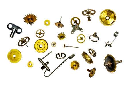 diminutive: Broken watch and watch cogwheels over white Stock Photo
