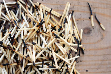 spent: Pile of matches on the wooden floor